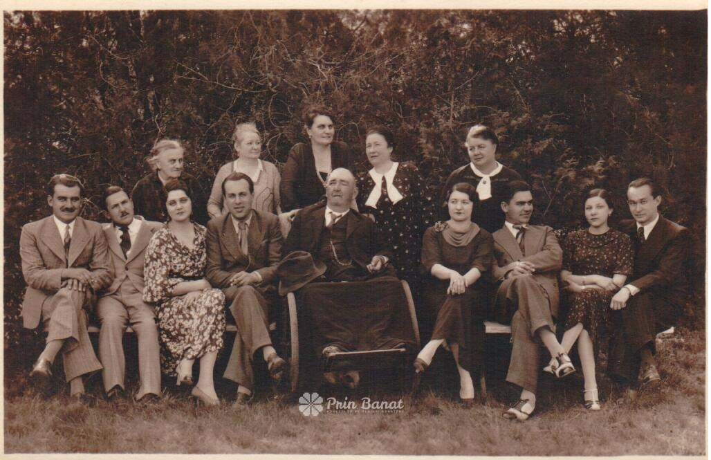 The Ivan Mučalov Senior family circa 1930. First row from the left: Milutin Mučalov (1909 - 1999), Unkown, Olga Mučalov (1903 - 1981), Unknown, Ivan Mučalov Senior (1868 - 1935), Unknown, Ivan Mučalov Junior (1907 - 1975), Unknown, Unknown. Second row from the left: Eugenie Dimitriades (1852 - 1947, mother of Jelena Lilič), Unknown, Jelena Lilič (1881 - 1947 wife of Ivan Mučalov Senior, also nicknamed Maika), Unknown, Unknown.